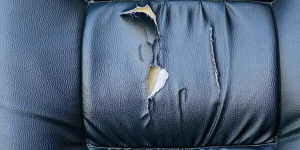 Torn car seat black